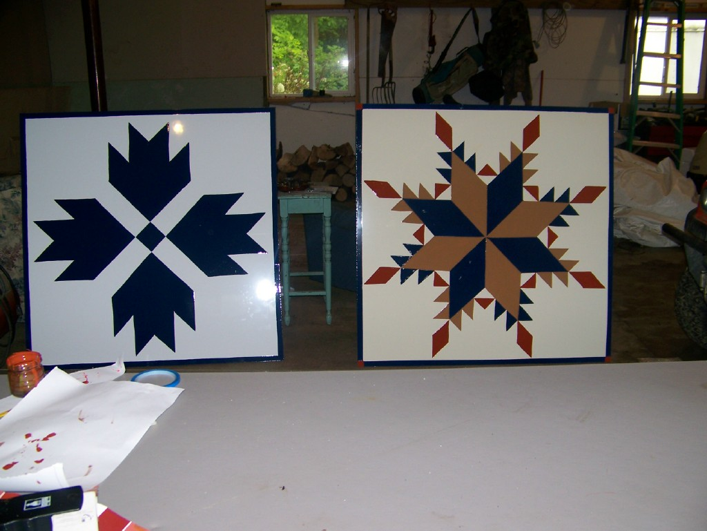 Freshly painted barn quilts
