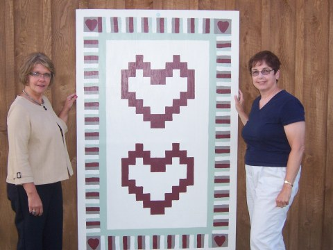 Crystal Abers and Sue Sandy with a Barn Quilt